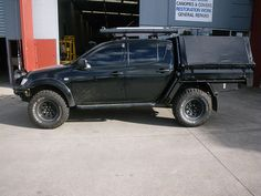 mitsubishi triton roll bar with storage - Pesquisa Google