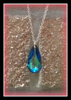 Stunning Bermuda blue Swarovski crystal Teardrop pendant on an 18'' or 24'' silver plated necklace chain. Please specify which at the checkout or message me after purchasing thank you. Please note we also do a purple version of this teardrop necklace on our website. I can do matching blue earrings on request please just ask me for prices and more info. We post to UK and Ireland for FREE.We also ship overseas. Please see postage terms and conditions for overseas postal in...