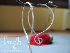 Sterling Silver Hoops with a Twist | tangle.etsy.com