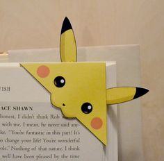 This is a bookmark designed by me, Pokemon inspired fan art. Meant to bite onto … This is a bookmark designed by me, Pokemon inspired fan art. Meant to bite onto the corner of a page. Printed on sturdy card stock. Dimensions: 6 x 6 cm (excluding ears) Bookmarks Kids, Bookmark Craft, Origami Bookmark, Handmade Bookmarks, Funny Pokemon Cards, Pokemon Cards For Sale, Paper Crafts Origami, Origami Art, Oragami