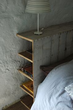 Love the hidden storage that this headboard has. Hidden storage behind the headboard. Great idea to go up the wall/headboard side of a platform bed. Maybe open up the opposite side under bed for shelving. Headboard With Shelves, Headboard Decor, Headboards For Beds, Diy Storage Headboard, Rustic Wood Headboard, Bookcase Headboard, Bedroom Storage, Bed With Shelves, Headboards With Storage
