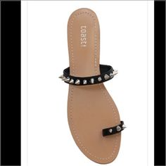NEW Black Spiked Rockstar Sandals Brand new in original box trendy Black with Silver Spikes Rockstar Sandals perfect for the summer! Gives a great edgy look, perfect with dresses, shorts and a pair of jeans. Shoes Sandals