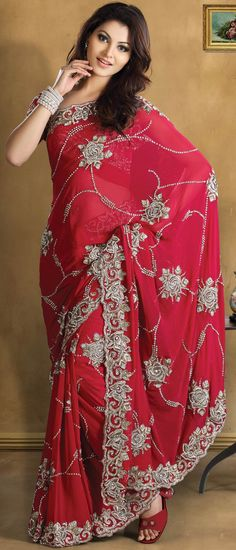 This red pure georgette saree is embellished with zari, kasab, sequins, stone, cutdana and patch work. As shown blouse can be made available and also can be customized as per your pattern subject to fabric limitation. Slight variation in color and patch patti pattern is possible.