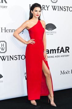 Pin for Later: 20 Times Kendall Jenner Brought the Heat in 2015and We Almost Couldn't Handle It Her Red-Hot amfAR Gala Dress Wearing a Romona Keveza dress and Christian Louboutin heels.