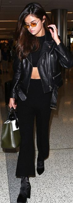 Who made  Selena Gomez's black leather jacket, handbag, and two tone handbag?