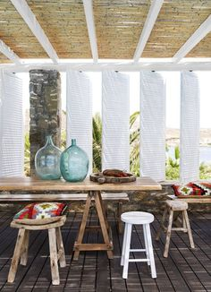 Pivot shutters on an al fresco dining porch.