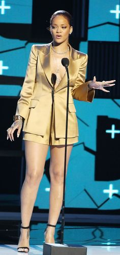 Rihanna in a gold Giorgio Armani suit at the 2015 BET Awards.