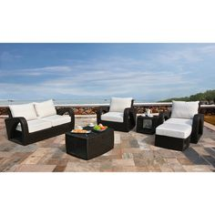 Corvus Settina 6-piece Resin Wicker and Sunbrella Outdoor Furniture Set You'll be proud to invite guests to your patio with this Settina six-piece outdoor furniture set by Corvus. The ottoman provides a great place to kick your feet up or to hold snacks and drinks, and the brown wicker complements the white cushions nicely. Rating 4.9|7 reviews Sale $1,997.99