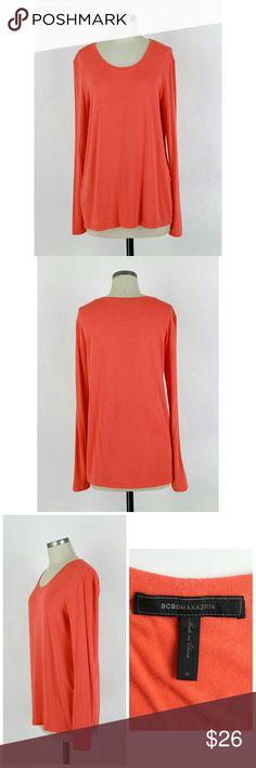 "BCBGMAXAZRIA Emi long sleeve tee Size Medium. BCBGMAXAZRIA Emi long sleeve tee.  Manufacturers color ambrosia (pinkish orange). Slightly sheer, finely ribbed jersey. 92% viscose 8% spandex. Gently used no flaws. Approximate measurements Bust 39"" Length 28.5"". BCBGMaxAzria Tops Tees - Long Sleeve"