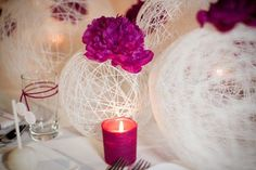 These are just really cool – and could be used as centerpieces or you could hang them like paper lanterns.  All you have to do is blow up a bunch of balloons in different sizes, wrap them with string, then lather them in fabric stiffener.  Pop the balloon – and you have this wonderful design!
