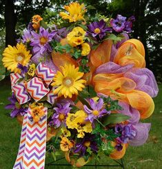 Vibrant and snazzy purple, yellow, and orange Summer wreath! Dare to be different and hang this striking wreath either in your home or on your front door! The stars of this wreath are the colorful large daisies and the brightly colored chevron ribbon. Purple Yellow, Orange, Chevron Ribbon, Wire Wreath, Wreath Forms, Deco Mesh Wreaths, Summer Wreath, Pansies, Daisy