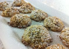 Walnut cookie – – nuts (, chopped finely), sugar, semolina, eggs ((separated)), cognac, baking powder, vanilla extract, orange (grated), powdered sugar, stick butter (melted), Preheat oven to 450 degrees; In large bowl, add chopped nuts, sugar, semolina and baking powder and mix well.; To this add the vanilla extract, cognac, grated orange rind and 2…