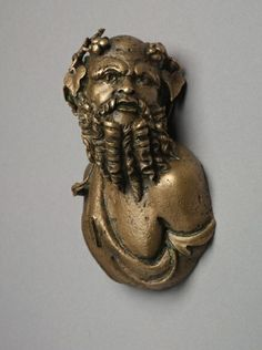 Silenus Bust for a Couch | Cleveland Museum of Art. Italy, Roman, 1st to early 2nd Century. bronze, Diameter - w:7.80 cm (w:3 1/16 inches) Overall - h:11.00 cm (h:4 5/16 inches). Andrew R. and Martha Holden Jennings Fund 1974.88