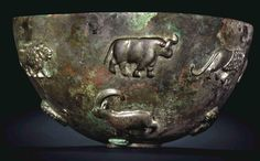 Sumerian Copper Bowl, Late Uruk-Jemdet Nasr Period, C. 3300-2900 BCDecorated with leopards, ibexes, lions and bulls