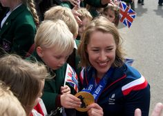 A St Michaels school child studies Lizzy's gold medal