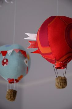 How cute would these be in kid's room? Hot air balloon mobile by Craft_Schmaft, via Flickr