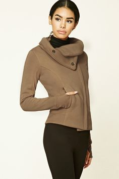 A fleece knit jacket featuring an asymmetrical zippered front closure, a snap-buttoned funnel neckline, on-seam front pockets, and long sleeves.