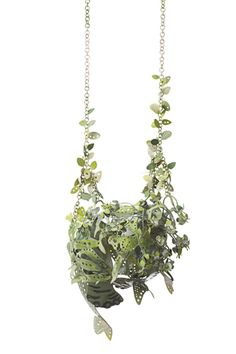This is the most amazing piece of jewelry I've seen in quite a while. Crazy!