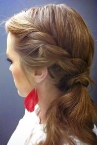 Twist braid to the side and pony tail wrap round to create a curly side hair-do:)