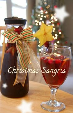Christmas Sangria 2 bottles Merlot 1 bottle ginger ale 1 cup sugar 1 tsp ground cinnamon tsp ground nutmeg tsp ground clove 4 to 6 oranges or tangelos 6 to 10 cinnamon sticks 1/2 bag of cranberries.