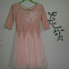 2 for $25 - Pretty in peach! Vintage looking dress Re-posh! Beautiful dress, but didn't fit :(   Color is peach. Fully lined. Pearl and lace design on front of dress (see 3rd pic). This is a pull-on dress. There is a very small zipper on the side that doesn't do much. This was originally purchased on a Chinese site and is labeled XL... but is actual a small-medium. Would better fit a small to medium chested person. *Included in 2 for $25* Dresses Long Sleeve