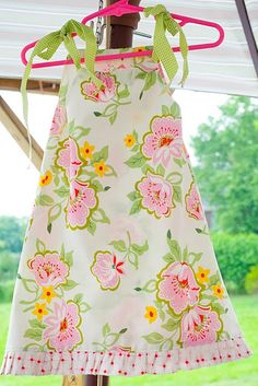 okay so not only is this tutorial for a super cute dress, it also shows you how to make a matching stroller quilt.  adorable!