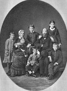 There is a family of Vladimir Ulyanov (later known as Lenin), the Bolsheviks' leader, a person who managed to put an end to the Empire and ordered to exterminate the Romanovs. He is sitting to the right. He had got a senior brother Alexander (stands in the center) who was hanged to death as a terrorist by Alexander III, Nikolay II's father. Nobody sympathized Lenin's family, friends left them and this fact impressed him greatly. Was the murder of the Romanovs a revenge? Who knows...