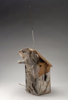 """""""Bruce Conner's 1959 'Walkie-Talkie' turns a modern technology into a decayed material object, an outstretched arm reaching through."""" Caption from link"""