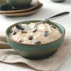 Arroz Con Leche (Rice Pudding) Recipe -Sweet and simple, this creamy dessert is real comfort food in any language. You'll love the warm raisin and cinnamon flavors. It's great served cold, too. —Marina Castle, North Hollywood, California