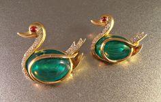 Trifari Flawed Emerald Rhinestone Swan Brooch Pair, Gripoix Glass, Alfred Philippe Jewels of India by LynnHislopJewels on Etsy https://www.etsy.com/listing/473439230/trifari-flawed-emerald-rhinestone-swan