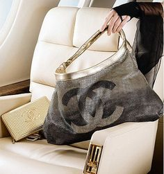 Chanel. Love the bag but what a beautiful aircraft!!!