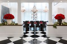 Red roses pop in Jenner's black-and-white dining area.