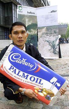 Highlighting the impact of demand for palm oil. Cadbury-Schweppes shareholder meeting, 2004.