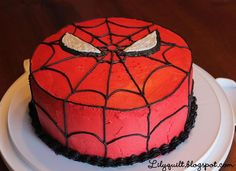 spiderman cake EPIC for birthdays...obviously. it's red & white fondant with tubed-out icing for web