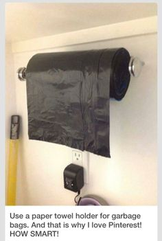 Hang a paper towel holder in the garage for trash bag storage.