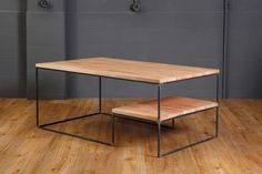 Coffee table with adjusted shelf. Steel frame and beech, oak or plywood surfaces.