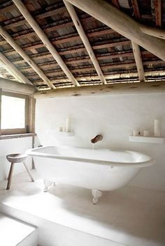 airy, open bathroom with bamboo spout:  natural palette by the style files, via Flickr