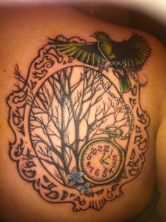Tattoo with bird, tree of life, and pocket watch with two times for the times of birth for my children
