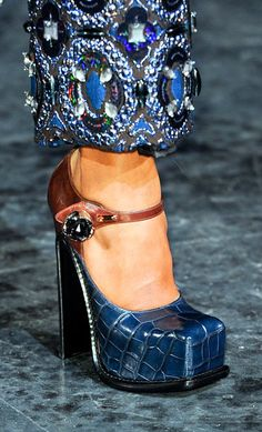 Square toes suddenly feel new again— the charmingly clunky platforms at Miu Miu, Prada, and Louis Vuitton all had them. This Mary Jane version stands out with its fresh mix of brown and navy with just a hint of sparkle in the rhinestone closure.