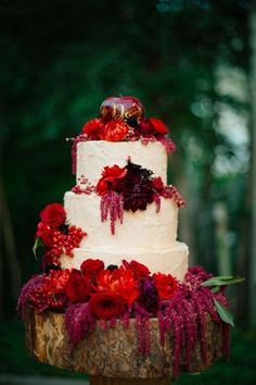 fall wedding cake with red flowers