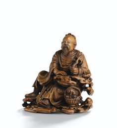 A FINELY CARVED BAMBOO-ROOT FIGURE OF A DAOIST IMMORTAL<br>QING DYNASTY, 18TH CENTURY | Lot | Sotheby's