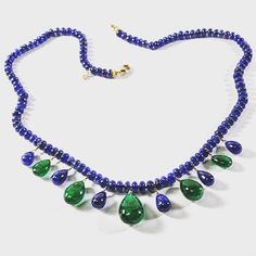 Splendid 's newly produced one-of-a-kind Sapphire and Emerald piece.  This 18 inch necklace features smooth Sapphire roundels accented with Emerald and Sapphire wire wrapped pear shaped drops.  Finished in 18 karat yellow gold.  So pretty!