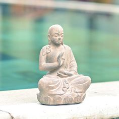 @Overstock - This sculpture of The Buddha heart mudra, emanates calmness and serenity. Made from volcanic ash, this Buddha reproduction will look magnificent in your garden or simply in a special place in your home.   http://www.overstock.com/Worldstock-Fair-Trade/Volcanic-Ash-Buddha-on-Lotus-Sitting-Statue-Indonesia/6000071/product.html?CID=214117 $34.99