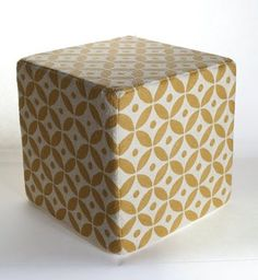 """Chain stitch is an ancient craft that can form flowing, curved lines that mimic drawing"""" in thread. Momeni's Chainstitch Ottomans are a beautiful accessory at 18""""x18"""" of 100% wool with a sturdy wooden base this accessory fits perfectly in to any setting."""""""