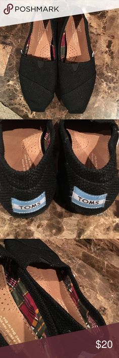 TOMS black flats Canvas black TOMS flats. Worn once. Size 5 inside has a plaid fabric. No box. TOMS Shoes Flats & Loafers