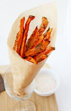 Tossed in egg whites instead of oil to crisp them up in the oven...GENIUS!    from: http://naturalnoshing.wordpress.com/2011/07/18/crispy-sweet-potato-fries/