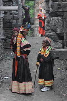 Kalash ladies in conversation in a street in Pakistan. Love the shoes!