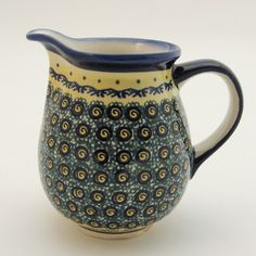 Hand-Painted Polish Pottery. i can imagine my fresh orange juice in this!