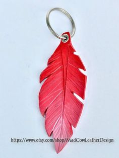Leather Feather Keychain https://www.etsy.com/shop/MadCowLeatherDesign Design tooled leather leather design keychain feather feather keychain leather feather