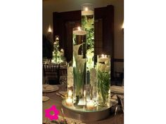 The table centerpieces will be tall vases at varying heights filled with submerged white calla lilies, white roses and white tulips with floating candles on top. Gorgeous for wedding centerpiece Wedding Centerpieces, Wedding Decorations, Table Decorations, Table Centerpieces, Centerpiece Ideas, Submerged Centerpiece, Quinceanera Centerpieces, Centerpiece Flowers, Elegant Centerpieces